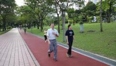 People run around the city park  of Kuala Lumpur, Malaysia Stock Footage