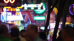 People outside bar on typical Hong Kong street at night. Stock Footage