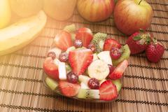 Diet healthy fruit salad warm filter applied - stock photo