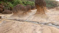 Through fantastic hoodoo landscape, mushroom stones, Yehliu Geopark Stock Footage