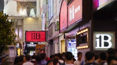Anonymous crowd hustling in typical Hong Kong district, slow motion. - stock footage