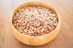 Multi whole grain of organic jasmine rice - stock photo