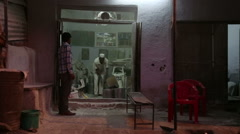 Indian men talking on the doorstep in the night time. Stock Footage