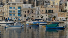 The view on traditional Maltese boats in sunset, Kalkara, Malta Stock Footage