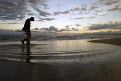 Fisherman beach fly man walk Stock Photos