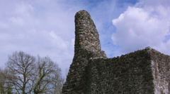 Castle ruins with tower against blue sky with clouds Stock Footage