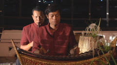 Musicians playing traditional instruments at Bangkok in Thailand Stock Footage