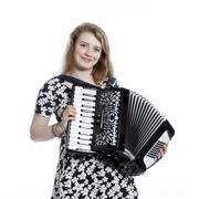 teenage girl in studio with accordion - stock photo