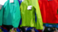 Inside of shop of outdoor. Tourist  outdoor clothes on angers. Blurred scene. 4K Stock Footage