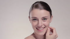 Fresh clear healthy skin on the face of beautiful woman over white - stock footage