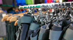 Inside of shop of outdoor. Tourist clothes on angers. 4K 3840x2160 Stock Footage
