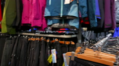 Inside of shop of outdoor. Tourist  outdoor clothes on angers. Panorama Stock Footage