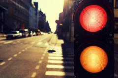 Traffic lights in the street at night in the spring at sunset - stock photo