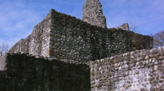 Stock Video Footage of Stone walls from castle ruins with tower against blue sky with clouds