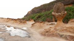 Landscape of Yehliu Geopark, walking on sandy eroded surface Stock Footage