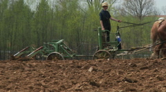 Amish boy plowing 8 - stock footage