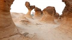 Flying camera at fantastic mushroom rock landscape, Yehliu Geopark Stock Footage