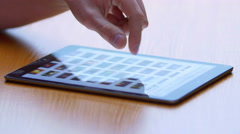 The hand (finger) work with touchscreen (ipad). Close up view Stock Footage