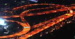 Aerial view of traffic lights at night on highway road with modern interchange - stock footage