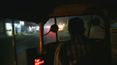 Fast motion at the back of a richshaw driving at night in the city. - stock footage