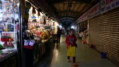 End of workday indoor market, souvenirs and snacks stalls, half closed - stock footage