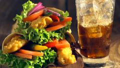 Snach wrap with chicken and vegetables served with cold drink - stock footage
