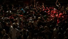 Crowd of young people dancing on party, slowmotion Stock Footage