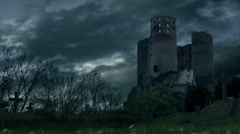 Stock Video Footage of Dark castle and cemetery during storm.