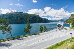 Car loading at small ferry terminal, fjord Norway Stock Photos