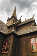 Old wooden stave church in Lom, Norway - stock photo