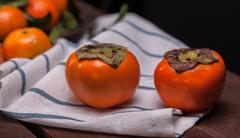Two persimmons Stock Photos