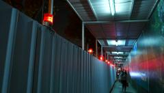Construction fence with warning flashlight, night time, corridor Stock Footage