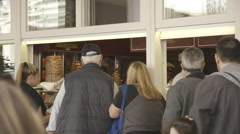 People waiting in line for an order of Greek souvlaki. Stock Footage