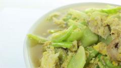 Dolly shot of cucumber stir fried with egg and pork Stock Footage