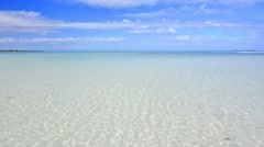 Wide angle of beautiful calm sparkling clear water of shallow lagoon with san Stock Footage