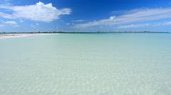 Wide angle of beautiful sparkling clear water of shallow lagoon in paradise s Stock Footage
