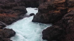 Water stream at the Hraunfossar waterfalls in western Iceland Stock Footage
