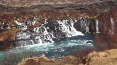 Waterfall at the Hraunfossar waterfalls in western Iceland Stock Footage