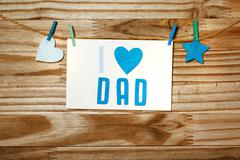 Fathers day message with felt heart and star - stock photo