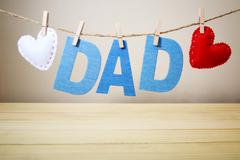 DAD text and felt hearts hanging on a string Stock Photos