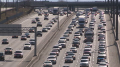 Toronto highway traffic jam at rush hour with sun reflecting off cars Stock Footage