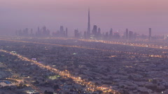 Skyline view of Dubai from night to day transition, UAE. Timelapse Stock Footage
