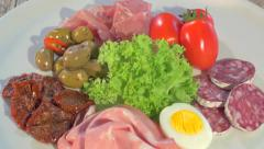 Italian appetizer on white plate rotating Stock Footage