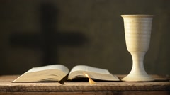 Stock Video Footage of open bible with chalice and cross, shallow depth of field,rack focus