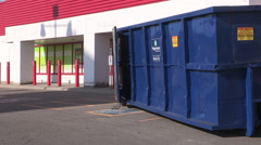 Closed empty vacant store with disposal bin out front in economic recession Stock Footage