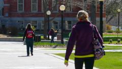 Stock Video Footage of College Students Walking Around Busy Campus on Cool Spring Day