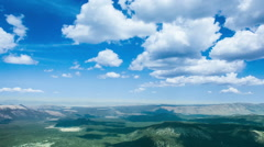 Time Lapse - Beautiful Clouds Moving Over Green Hills Stock Footage