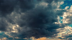 4K sky sunset time lapse storm clouds disperse sun emerges 30p Stock Footage