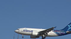 Transat airplane in flight and descending towards the airport - stock footage