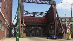 Chicago - sports car drives over girder bridge Stock Footage